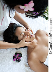 Young woman enjoying a massage day at the spa