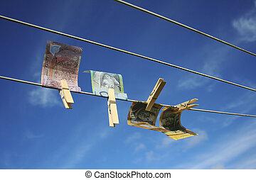 Money laundering - Australian notes pegged on washing line...