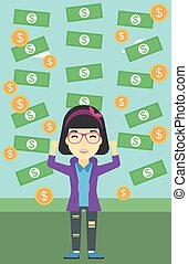 Happy businessman under money rain. - An asian young...