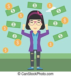 Happy business woman under money rain. - An asian business...