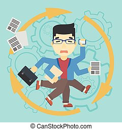 Businessman coping with multitasking - An asian businessman...