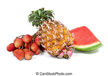 Fruit arrangement of watermelon, pineapple and lychees isolated