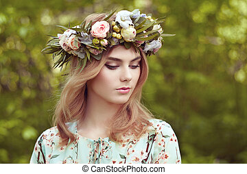 Beautiful blonde woman with flower wreath on her head....