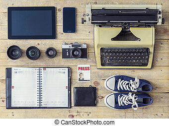 Journalistic equipment: typewriter, tablet, phone, camera,...