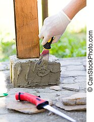 With glue will fix stones well - Hand with glove sticking...