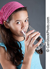 Young girl with a glass of water, concept of healthy...