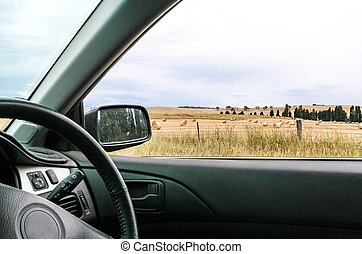 View of country paddocks from car window - Interior of car...