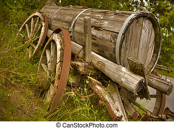 Old Wagon - Old abandoned western wagon in warm evening...