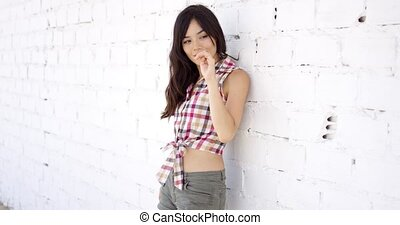 Content woman wearing shorts and checkered top spreads her...