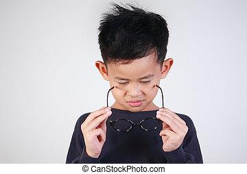 Little Boy Wearing Glasses - Portrait of little Asian boy...