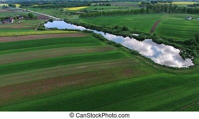 aerial view of river in the fields - aerial view of river in...