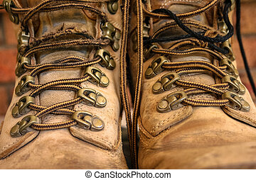 Old worn lace up work boots - Tan and brown old lace up work...