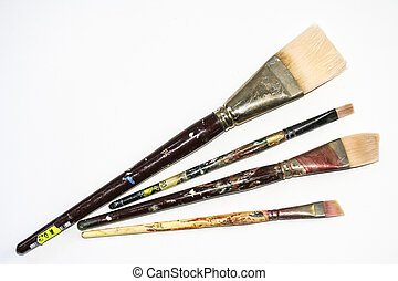 Group of four paint brushes spread out
