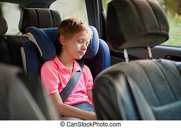 cute little boy sleeping in car seat