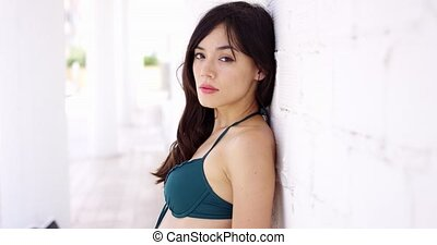 Gorgeous woman leaning against wall - Single female adult...