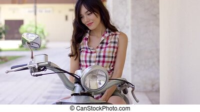 Attractive young woman on a motorbike - Attractive smiling...