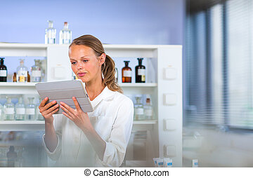 Portrait of a female researcher doing research in a lab,...