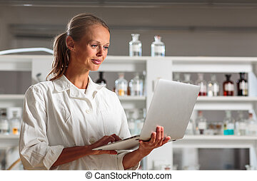 Portrait of a female researcher doing research in a...