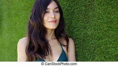 Beautiful young woman wearing green bikini top