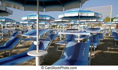 Adriatic beach umbrellas and sunbeds