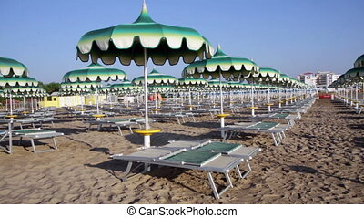 Adriatic beach umbrellas and sunbeds