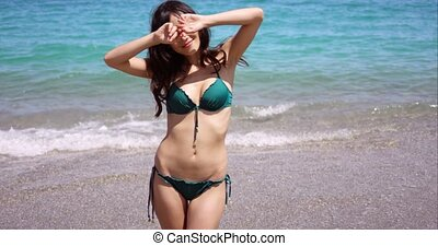 Shapely young woman in a bikini at the beach