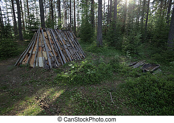 Stone age tent and fireplace in Naesaaker in Sweden.