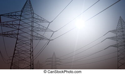 Electricity transmission. Power line against sunny sky,...