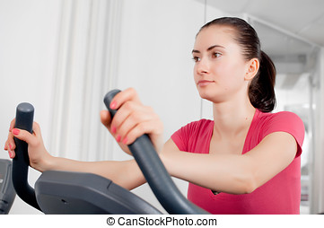 woman on the exercise bicycle