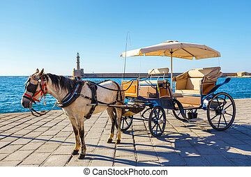 Horse carriage for transporting tourists in old port of...