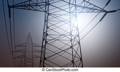 Power pylons and wires against cloudless sky, dolly shot. 4K...