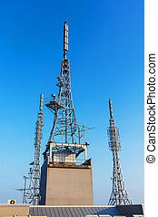 antenna repeater, sattelite, 3g, 4g tower on blue sky