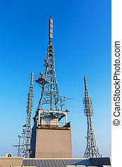 antenna repeater, sattelite, 3g, 4g tower on blue sky
