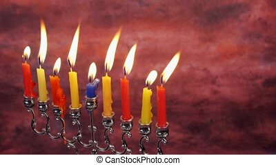 Beautiful lit hanukkah menorah on black background....