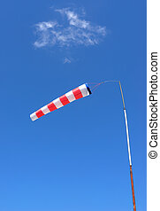 Windsock - Red and white windsock made of fabric hangs...