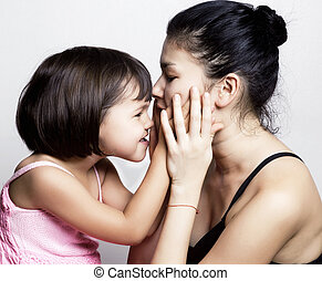 Mother and daughter together - Portrait of daughter and her...