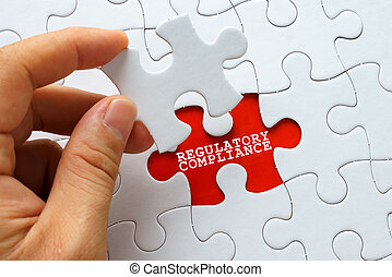 White puzzle with word REGULATORY COMPLIANCE