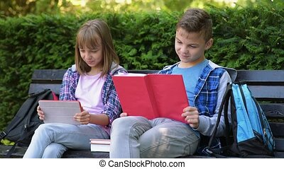Boy and girl reading book - Teen cute boy and gir reading...