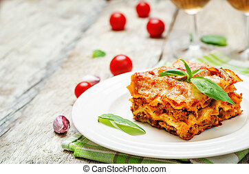 Meat lasagna on a white wood background. toning. selective...