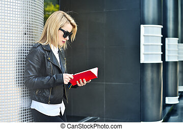 girl reading red book - young hipster girl reading red book,...
