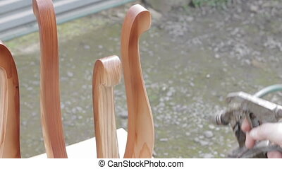 Carpenter is covering stool by lacquer Furniture varnishing...