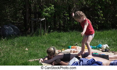 Girl with parents on picnic - On carpet is Mom and Dad...