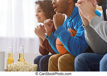 Friends watching sport on TV - Let is score goal. Close up...