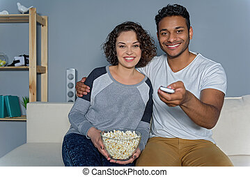 Young couple preparing to watch movie - Long-awaited series....