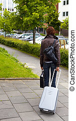 leaving  - woman leaving the hotel