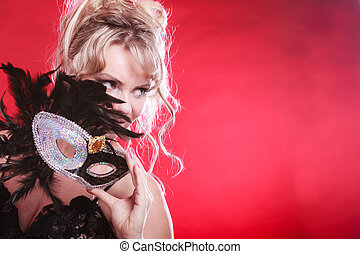 Woman with carnival mask - Party entertainment time concept...