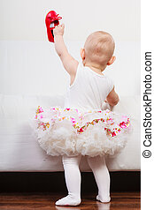 Little girl with red shoes - Lesson of walking Sweet...