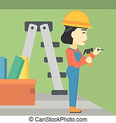Constructor hammering nail - An asian female worker...