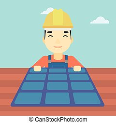 Constructor with solar panel - An asian man installing solar...