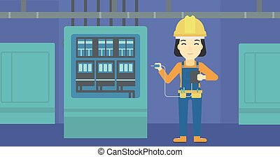 Electrician with electrical equipment - An asian woman in...